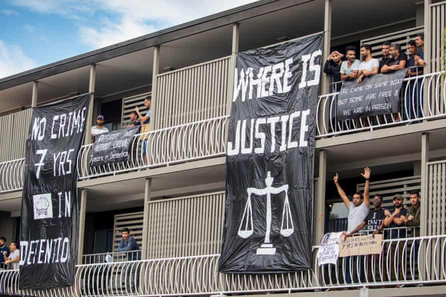 Asylum seekers on the balcony of the Kangaroo Point Central hotel during a 'Free The Refugees' in June 20202.