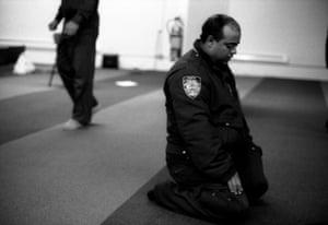 NYPD Traffic Officer at prayers, Park 51, Manhattan, 2012