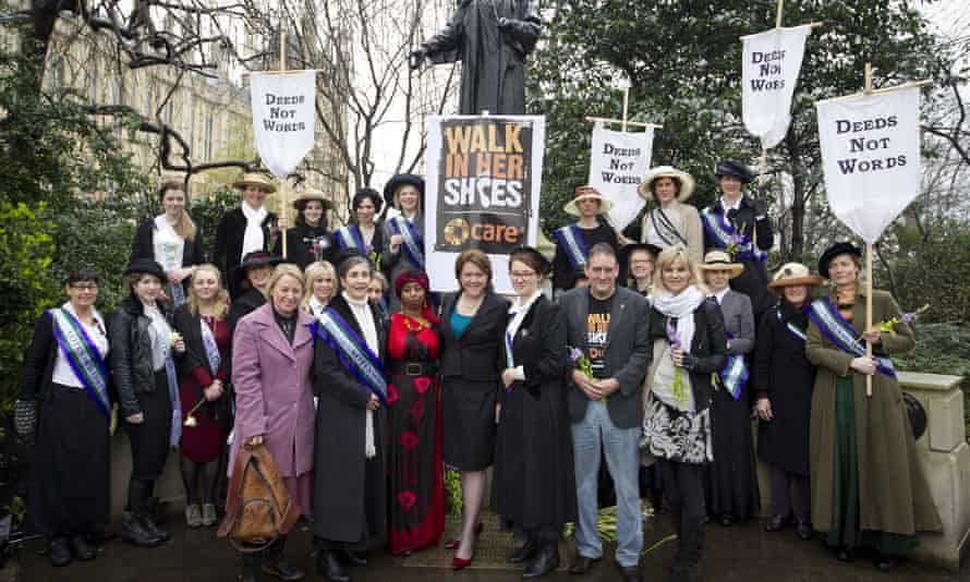 Miller with women dressed as suffragettes for poverty charity Care International's Walk in Her Shoes campaign, March 2013