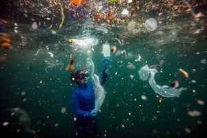 Diving in sea full of plastic