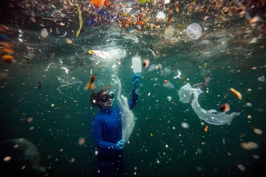 Turkish world record-holder freediver Sahika Encumen dives amid plastic waste on the Ortakoy coastline to observe the life and pollution of the Bosphorus in Istanbul on 27 June.