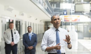 US-POLITICS-OBAMA-PRISON<br>US President Barack Obama speaks as Charles Samuels (C), Bureau of Prisons Director, and Ronald Warlick (L), a correctional officer, look during a tour of the El Reno Federal Correctional Institution in El Reno, Oklahoma, July 16, 2015. Obama is the first sitting US President to visit a federal prison, in a push to reform one of the most expensive and crowded prison systems in the world. AFP PHOTO / SAUL LOEB (Photo credit should read SAUL LOEB/AFP/Getty Images)
