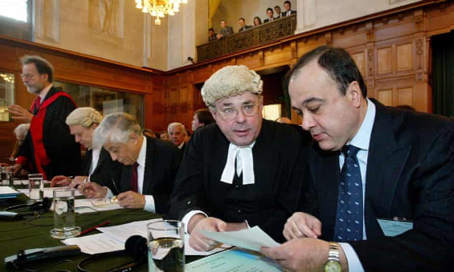 James Crawford, foreground left, talking to Nasser Al-Kidwa, head of the Palestinian delegation, before public hearings about the construction of a wall in occupied Palestinian territory at the international court of justice in The Hague, Netherlands, 2004.