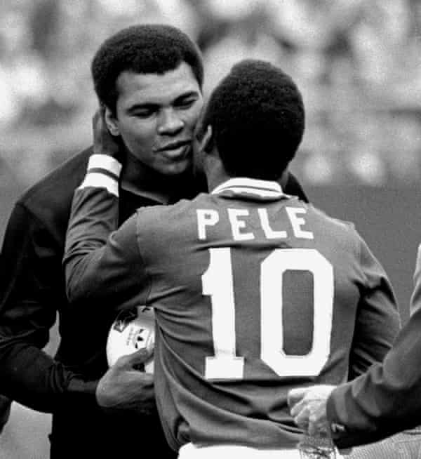 Pelé embraces the boxer Muhammad Ali during a ceremony honouring the Brazilian in 1977