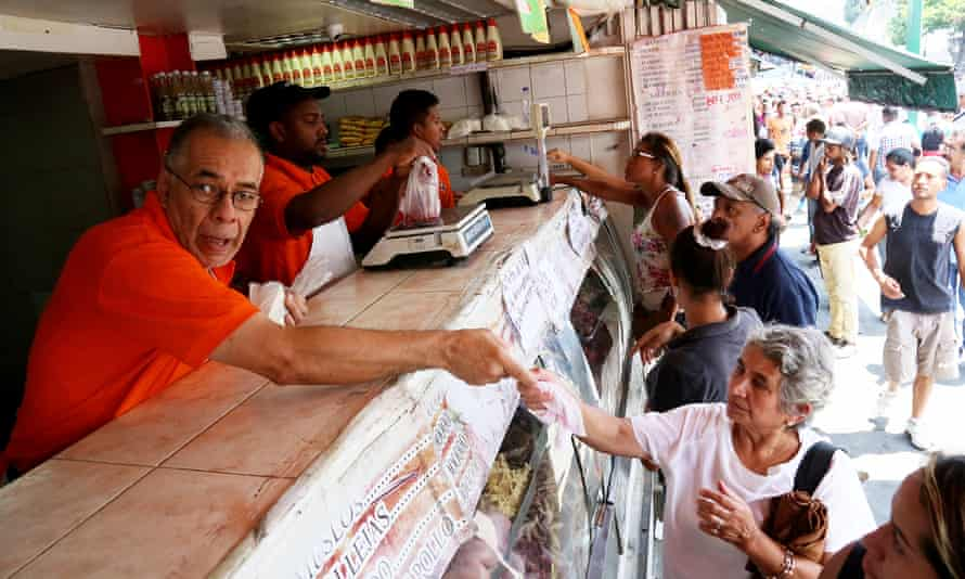 Caracas residents shop for food. Venezuela has now endured one of the longest runs of warp-speed price rises in the world.