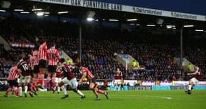 Joey Barton's cheeky free-kick gives Burnley the lead.