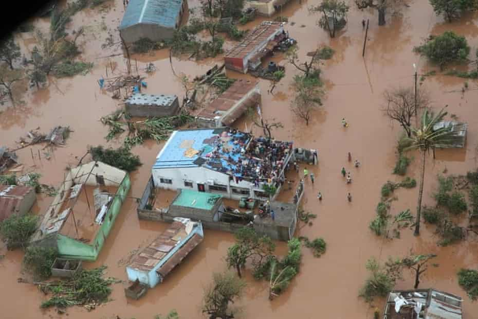 Survivors clinging to buildings in the district of Buzi, Mozambique