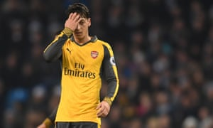 Mesut Özil looks dejected after the final whistle in Arsenal's 2-1 defeat to Manchester City in the Premier League