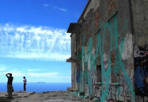 Cloud and grafitti on the Albania RivieraPhotograph: Penelope Farmer/GuardianWitness