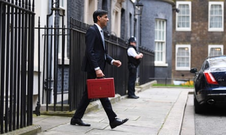 Rishi Sunak walking in Downing Street with a parliamentary red box.