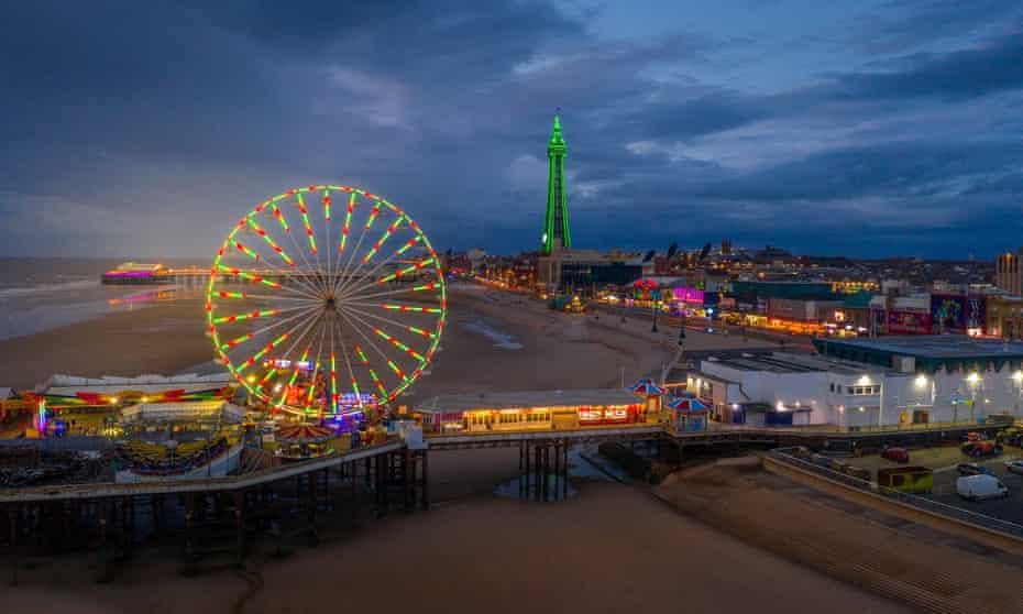 Blackpool beach, tower and illuminations. Seen at night.