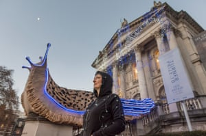 Monster Chetwynd with one of her illuminated slugs at Tate Britain in London.