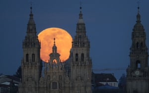 A view of the supermoon rising behind the cathedral in Santiago de Compostela.