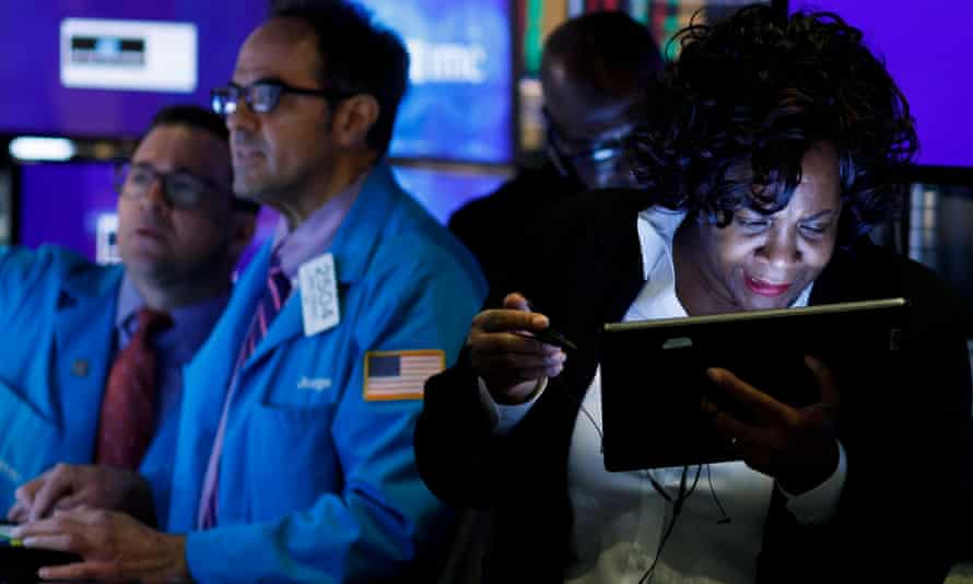 Traders and floor officials at work at the New York Stock Exchange on Monday.