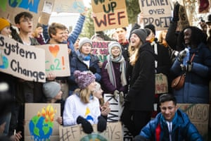 """Swedish climate activist Greta Thunberg, center, is pictured during a """"Fridays for Future"""" demo on the final day of the 50th annual meeting of the World Economic Forum, WEF, in Davos, Switzerland, Friday, Jan. 24, 2020. (Gian Ehrenzeller/Keystone via AP)"""