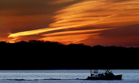 The lobster boat Deborah & Megan II motors out to sea at dawn, Thursday, May 21, 2020, off South Portland, Maine. The fishing industry is hoping for brighter days as they endure the hardships of a collapsed market due to the ongoing coronavirus pandemic. (AP Photo/Robert F. Bukaty)