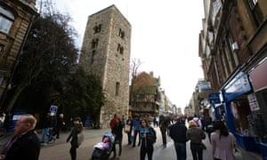 Shoppers walk along Cornmarket Street