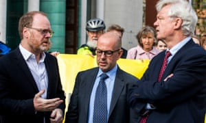 The investigative journalists Trevor Birney, left, and Barry McCaffrey, centre, with the MP David Davis outside Belfast high court