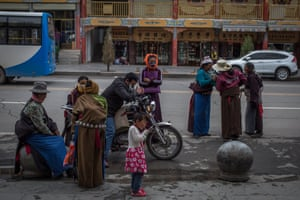 Ethnic Tibetan people stand in the street near the Labrang Monastery, in Xiahe, an ethnically-Tibetan town in Gansu province, China