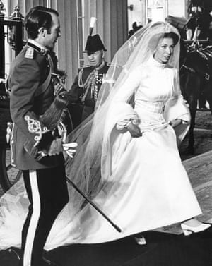 Princess Anne and Captain Mark Phillips arriving at Buckingham Palace after their wedding in 1973. Maureen Baker had to keep silent about the dress's design for months.