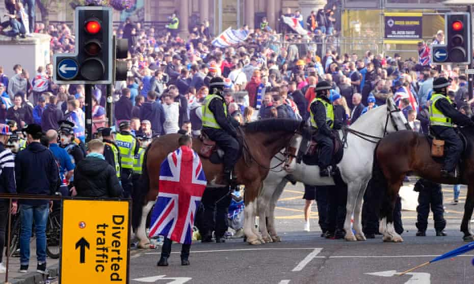 Police Scotland officers block access to George Square, Glasgow where Rangers fans celebrate their team winning their 55th league title on 15 May.