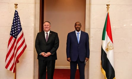 Mike Pompeo, left, stands with Sudanese Gen. Abdel-Fattah Burhan, right, the head of the ruling sovereign council, in Khartoum.
