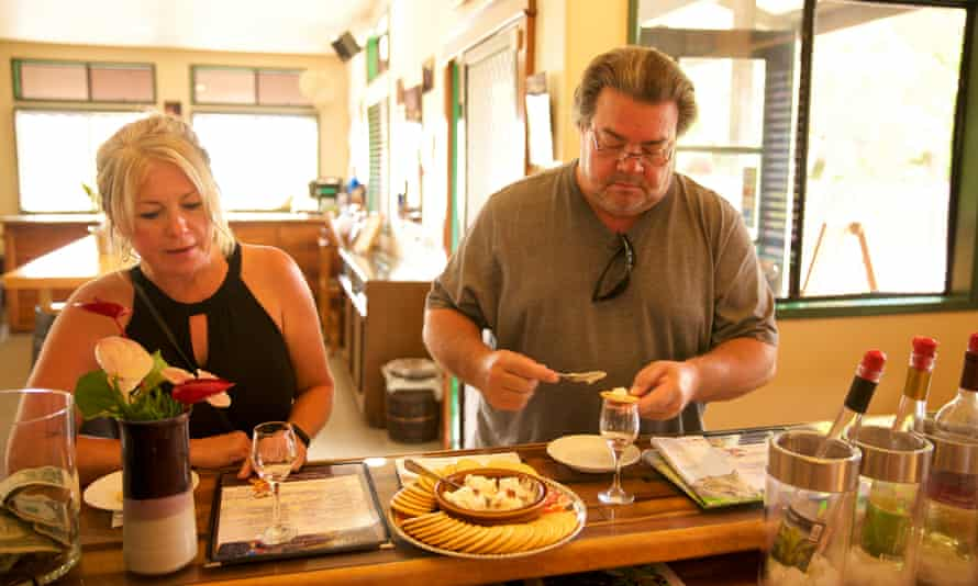 Visitors taste wine and cheese at Volcano Winery. Employees at the winery said wine would slosh in the vats during earthquakes.