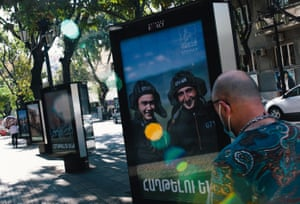 A man walks past advertising boards in the centre of Yerevan showing pictures from the Nagorno-Karabakh frontlines