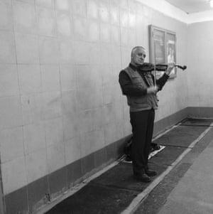 A man plays the violin in the Borovitskaya station, outside the Kremlin walls.