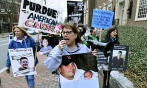 Cheryl Juaire, center, leads protesters near the Arthur M Sackler Museum at Harvard University, Friday 12 April 2019.
