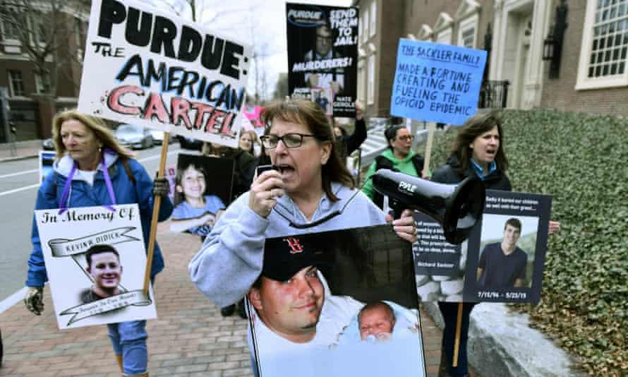 Cheryl Juaire, center, of Marlborough, Massachusetts, center, leads protesters near the Arthur M Sackler Museum at Harvard University, on 12 April.