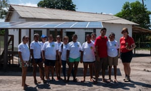 Volunteers outside a solar-powered fruit pulping facility in the Tapajós-Arapiuns Extractive Reserve in Para, Brazil