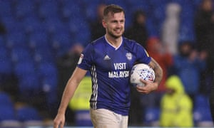 Joe Ralls walks off the pitch with the match ball after Cardiff's win.