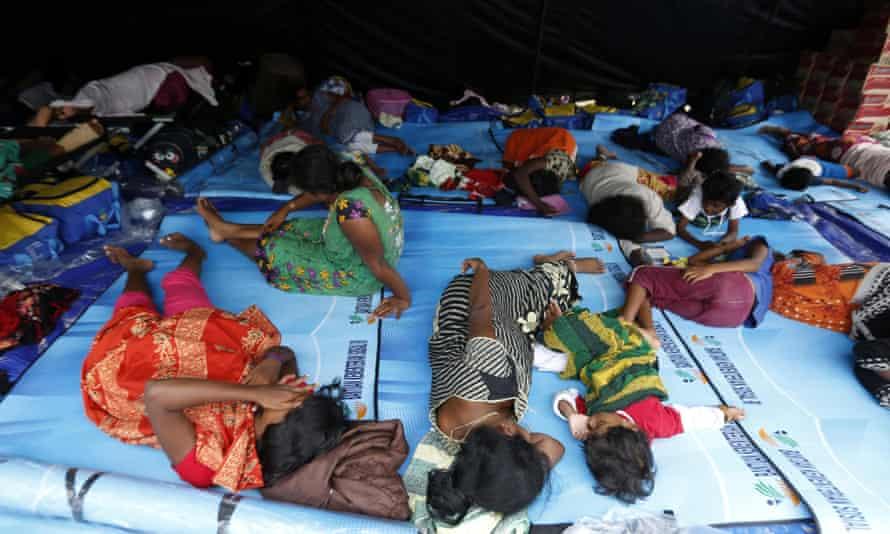 Sri Lankan asylum seekers rest inside a tent