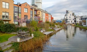 Houses by the canal in Malmö, Sweden, where a city policy required all housing blocks to meet a 'green space factor'.