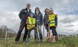 Pupils Alfie Perry and Dempsey Owens are pictured with Lesley Griffiths, centre, Chris Matts, left, and Natalie Buttriss at the Woodland Trust planting