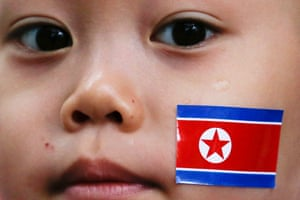 A child's face with a North Korean flag on it