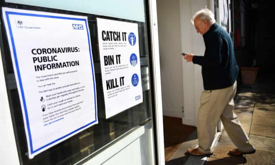 An elderly man walks into an NHS health centre in London