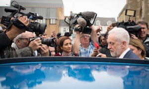 Jeremy Corbyn surrounded by journalists in Peterborough earlier.
