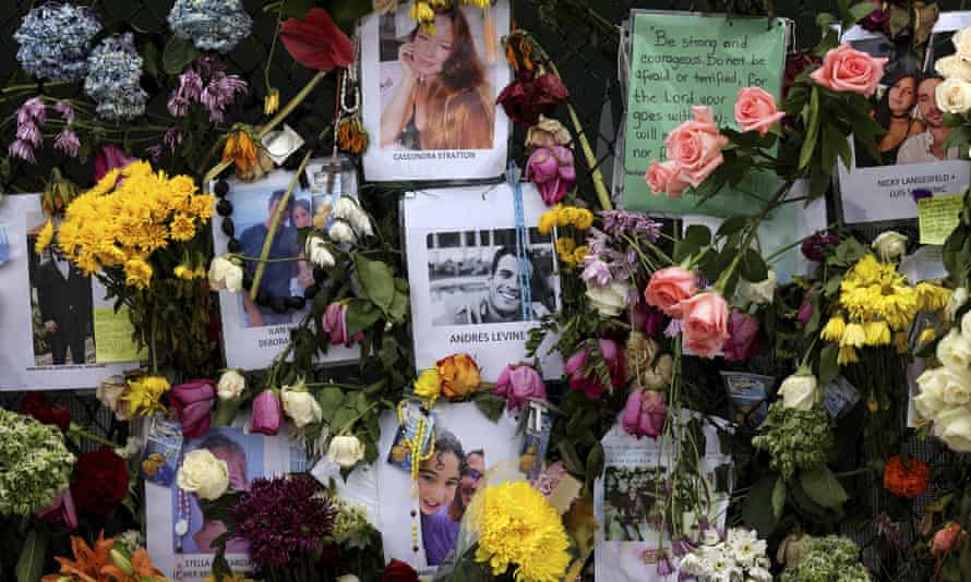 Photographs of victims hang on a memorial wall along a fence near the site at the Champlain Towers South Condo in Surfside, Florida, on Wednesday.