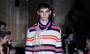 On of the male model on the catwalk for Gucci.