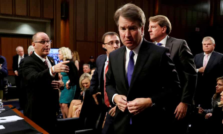 Brett Kavanaugh at his confirmation hearing in September 2018. Fred Guttenberg, the father of Jaime Guttenberg, a victim of the Parkland shooting, reaches out to try to shake Kavanaugh's hand.