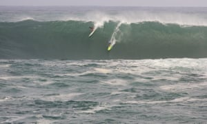 Jamie Mitchell, right, and Ross Clarke-Jones, both of Australia, share a wave.