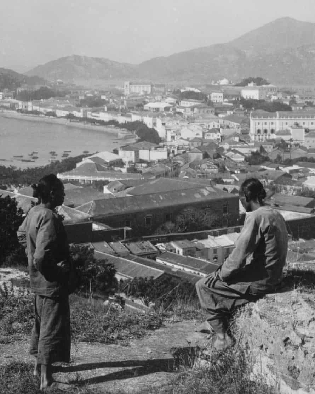 Chinese workers overlook Macau harbour, circa 1910