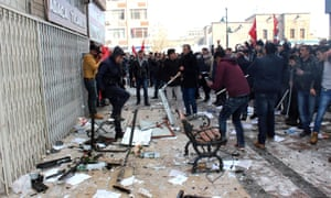 People protest in front of the offices of the pro-Kurdish Peoples' Democratic party (HDP) following a suicide car bombing on Saturday in Kayseri.