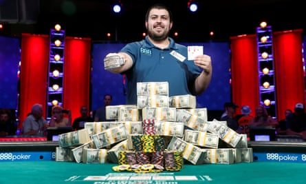 Scott Blumstein poses with his championship bracelet and cards after winning the World Series of Poker main event in Las Vegas