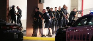 Dallas Police respond after shots were fired during a protest of fatal police shootings earlier this week in Louisiana and Minnesota, Thursday, July 7, 2016, in Dallas. Snipers opened fire on police officers during the protests; several officers were killed, police said. (Maria R. Olivas/The Dallas Morning News via AP)