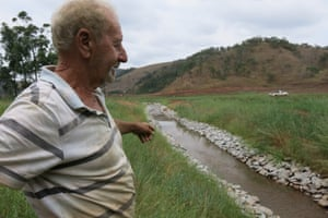 Ivaldil de Souza surveys a stream on his property