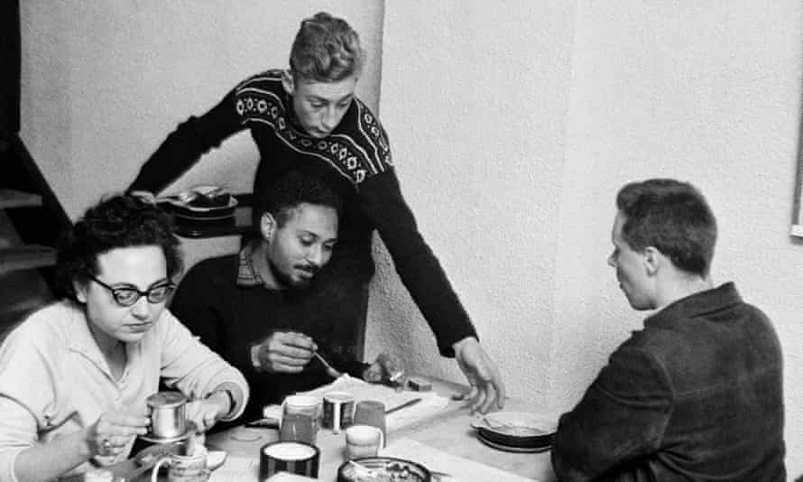 The social and cultural theorist  Stuart Hall (seated facing) at the Partisan.