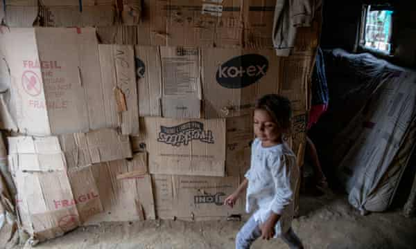 Venezuelan refugees living in La Pista must use cardboard for their shacks until they can find some metal.